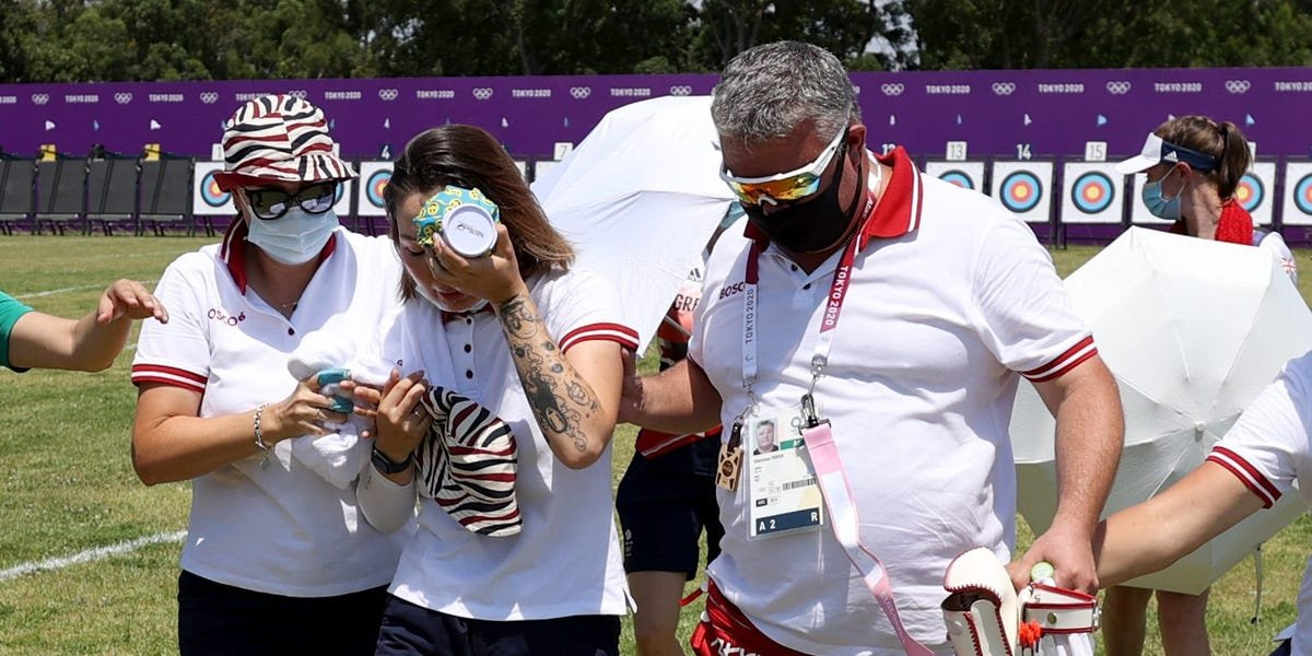 An Olympic archer collapsed and had to be helped out of the arena as sweltering temperatures hit Tokyo