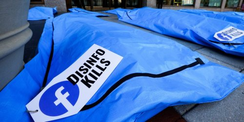Photos show body bags that read 'disinfo kills' outside of Facebook's DC office to protest vaccine misinformation on the platform