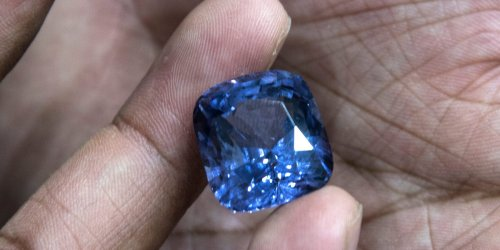 Workmen digging a well in a man's backyard discovered a $100 million windfall — a cluster of 2.5 million sapphire carats