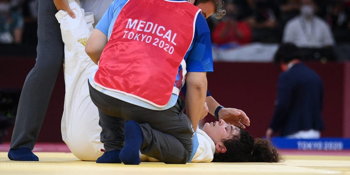 A Russian judoka passed out on the mat after being put in a brutal chokehold by her Japanese opponent