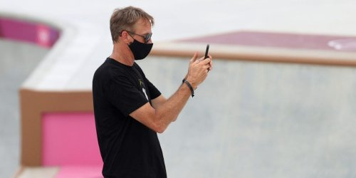Tony Hawk was taking photos like a proud dad at the women's skateboarding debut at the Olympics