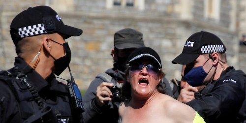 A topless woman who shouted 'save the planet' during Prince Philip's funeral was arrested outside Windsor Castle