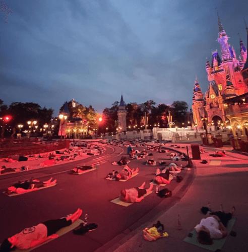 Disney World President Joins Cast Members In Magic Kingdom Yoga