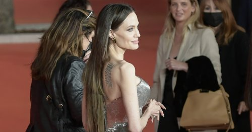 See Angelina Jolie's Hair Extensions Fail at Premiere: Photos