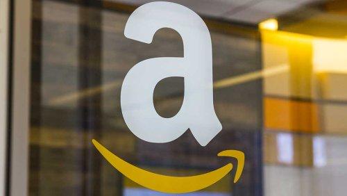 Dow Jones Drops As Caterpillar Weighs; Amazon Dives Below Key Support