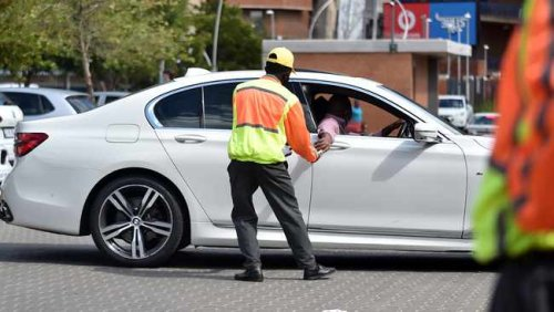 Hard work pays off for car guard turned MBA graduate