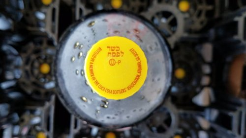 Why some Coca-Cola bottles have a yellow cap