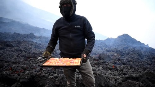 Order up! Man cooks pizza on volcano
