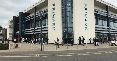 Shoppers queue for Debenhams and Primark at Westwood Cross for a second day