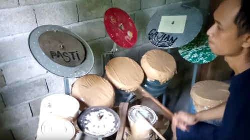 """Guy builds homemade drum kit, plays along to """"Tom Sawyer"""" on it"""