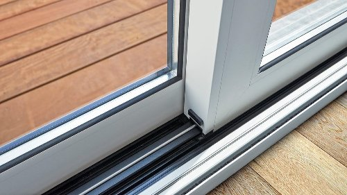The Easiest Way to Clean Gunk Out of Your Sliding Door Track