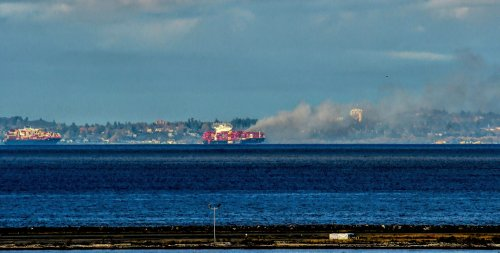 Cargo ship that lost containers off Washington coast catches fire near Victoria, most crew evacuated