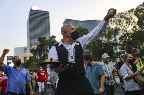The Latest: Las Vegas workers march to urge more rehiring