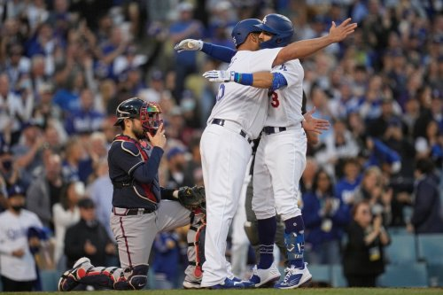 Dodger fans cheer the Boys in Blue as team returns to Atlanta to face Braves in Game 6 of NLCS
