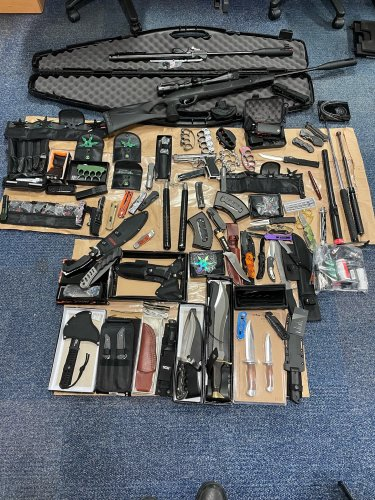 Stash of weapons including knuckle dusters, knives and CS spray seized in raid