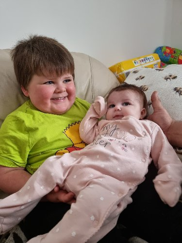 Battling baby Edith's trip back to her home to meet step-brother