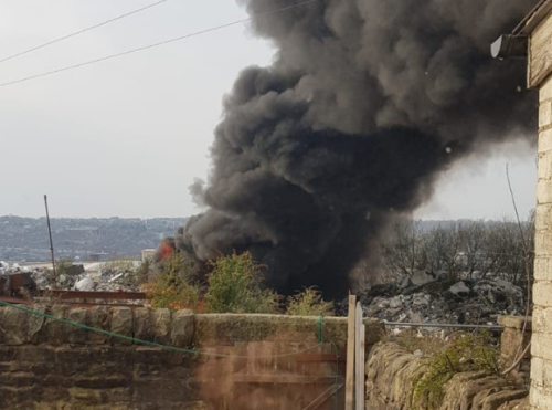 Huge fire breaks out at former plastics factory sending plumes of thick black smoke into sky