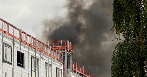 Road in Chorley closed after fire sees smoke pour from new development