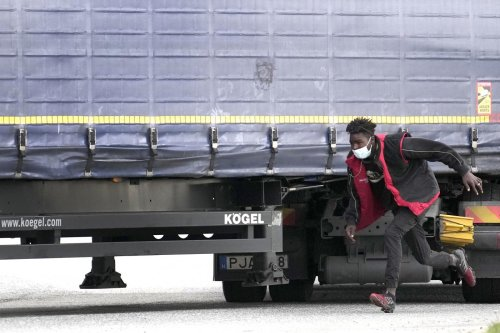 Jumping onto trucks to get to Britain: A migrant's day