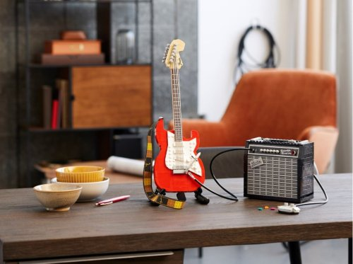 A LEGO Fender Stratocaster Guitar With an Amp, Tuning Pegs, a Pickup Switch, and an Iconic Whammy Bar