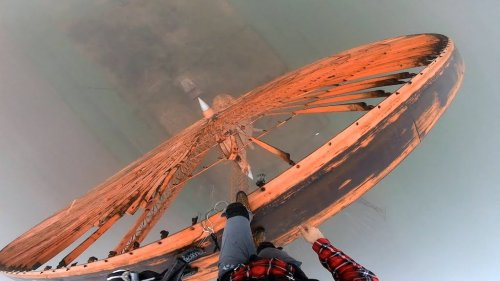 Daredevil Makes an Amazing 50 Meter Base Jump Off a Unique Abandoned Wind Turbine in Poland