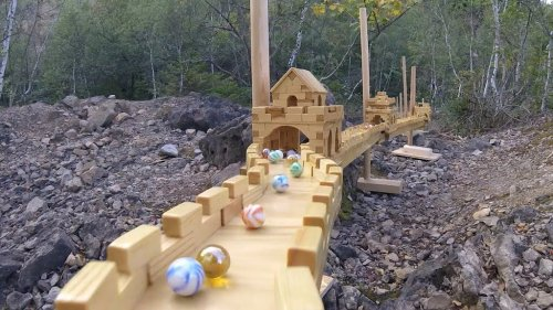 A Mesmerizing Marathon Marble Run Over a Miniature Wooden Replica of the Great Wall of China
