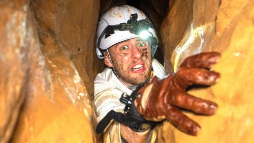 Man With an Intense Fear of Tight Spaces Crawls Through the Most Claustrophobic Cave in the World