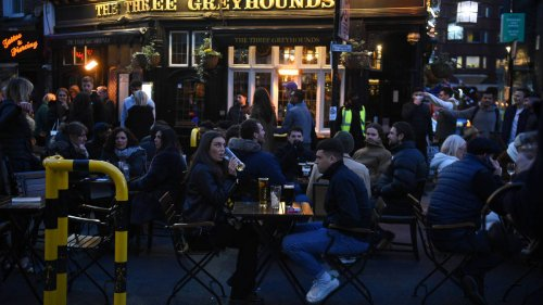 Drinkers flock to England's pubs in first Friday night since hospitality returned