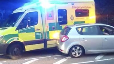 Petrol station chaos: Ambulance crashes into car trying to get past long fuel queue