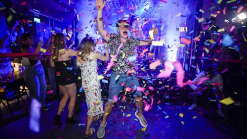 Party-goers celebrate end of lockdown as nightclubs reopen from midnight