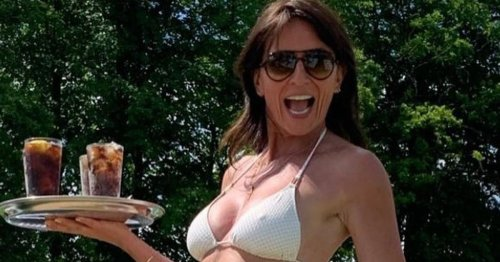 Davina McCall shows off 'phenomenal' abs in white bikini