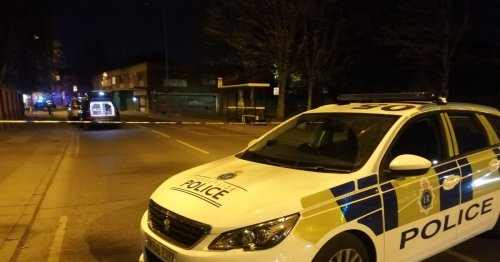 Live updates as armed police cordon off major city road