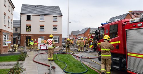 Two taken to hospital after fire rips through houses