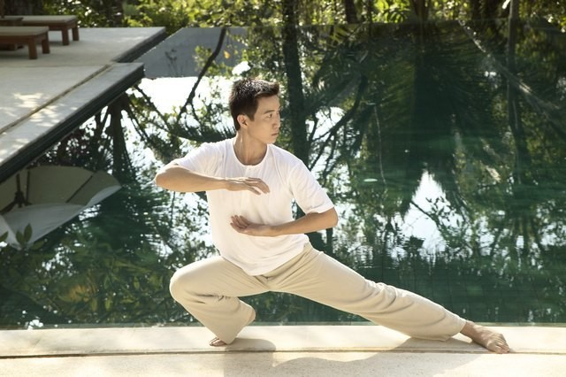 Stop Sitting and Stressing With This 3-Move Tai Chi-Inspired Routine