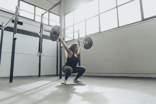 Struggling With Your Overhead Squat? Here's What Your Body Is Trying to Tell You
