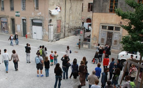 An art piece in itself – French artist Thierry Mandon leaves onlookers surprised as he casually reads a book on a bed dangling from an abandoned building.