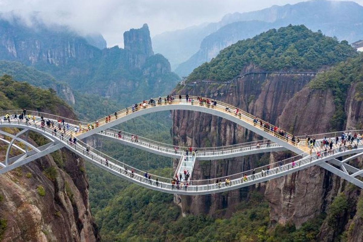 Made from transparent glass this double deck bridge in China looks so scary that netizens thought it was fake and just 'too crazy to even exist'