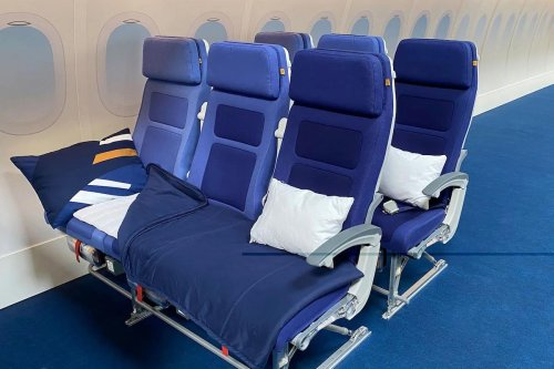 Lufthansa's new Sleeper's Row is the next best thing to business class with three seats to snooze, pillows, blankets, and more on long-haul flights