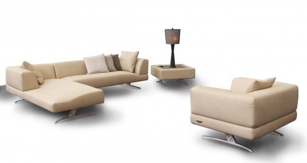 2013 Aston Martin Interiors collection's sofa and bed sport the iconic wings logo - Luxurylaunches