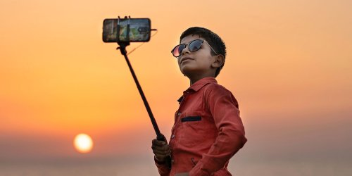 How to Convert Your Smartphone Into a Street Photography Camera