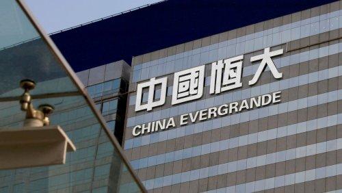 Chinas taumelnder Immobilienriese Warum Evergrande am Samstag pleite sein könnte