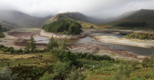 """Images show """"lost village"""" reappear in Lake District reservoir"""