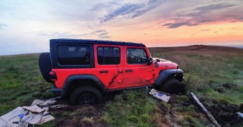 Off-roaders rescued from 4x4 after getting stuck in 'dangerous' marsh