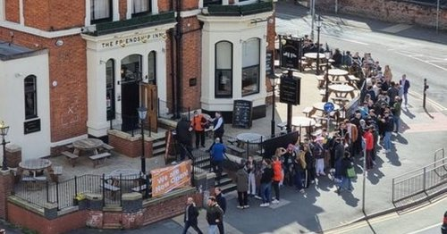 Punters reflect while they wait in massive queues outside pubs across Manchester