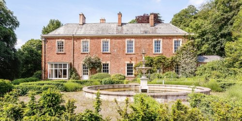 Evelyn Waugh's Former English Country Manor Has 12 Bedrooms and a Party Barn