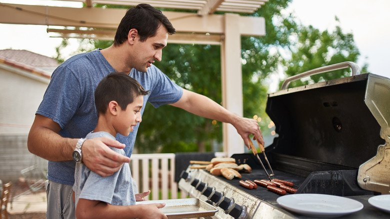 Chef Reveals The Mistake Everyone Makes When Grilling Hot Dogs