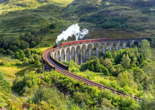 10 magnificent UK train journeys through seaside towns, national parks, and mountain peaks