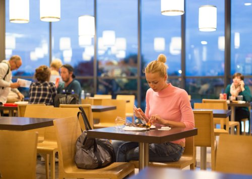 This little-known program lets you eat for free at many airport restaurants