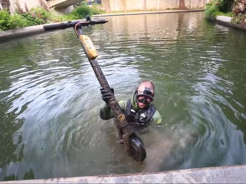 YouTube treasure hunter is the first to dive the San Antonio River Walk. Here's what he found.