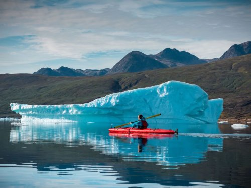 In Greenland, kayak between icebergs to reach an ancient, rumbling glacier